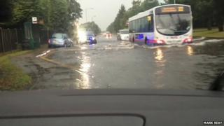Bus moving through flooded road in Canvey Island