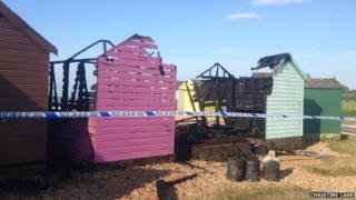 Fire damaged beach huts at Calshot