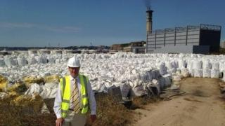 Deputy Kevin Lewis with the bags of ash