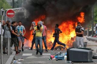 Rioters face police in Sarcelles, northern Paris, 20 July