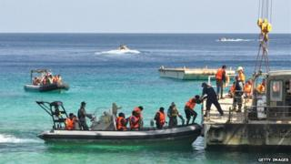 Suspected asylum seekers arrive at Christmas Island, after receiving assistance by Australian Navy, on 13 October 2012 on Christmas Island.