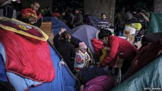 Asylum seekers living in a slum in France