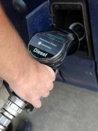 A motorist filling his van with diesel