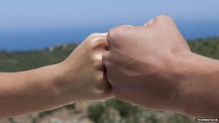 Fist bumping