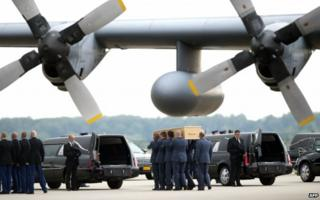 Dutch military personnel carry coffins containing the remains of the victims of the MH17 plane crash - 25 July 2014