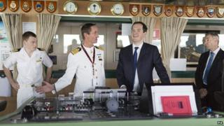 George Osborne, second right, with Captain Chris Wells, second left, during a visit to the Cunard cruise liner Queen Mary 2 at Southampton docks