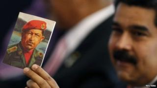 Maduro holds a picture of Chavez
