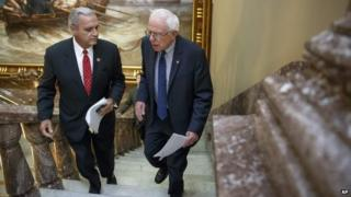 Senate Veterans' Affairs Committee Chairman Sen. Bernie Sanders, I-Vt., right, and House Veterans' Affairs Committee Chairman Rep. Jeff Miller, R-Florida., walk up stairs to the Senate TV studio for a news conference on Capitol Hill, 28 July 2014