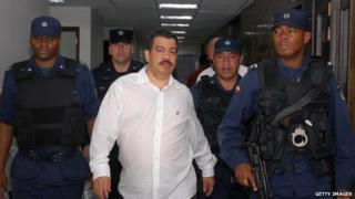 Diego Murillo surrounded by police officers