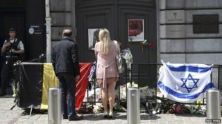 A couple looks at tributes outside the Jewish Museum in Brussels - 1 June 2014