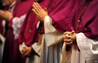 Hands of clergy in prayer