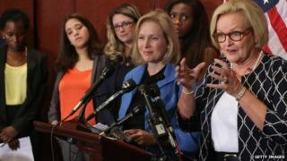 Sen. Claire McCaskill (D-MO) (R) and Sen. Kristen Gillibrand (D-NY) are joined by survivors of campus sexual assault during a news conference at the US Capitol Visitors Center 30 July 2014