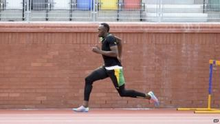 Usain Bolt training near Hampden
