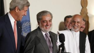 US Secretary of State John Kerry (L) and Afghan presidential candidates Abdullah Abdullah (C) and Ashraf Ghani (R) smile as they speak at a press conference announcing an audit of the votes cast in the country's general election at the United Nations Compound in Kabul on late July 12, 2014.