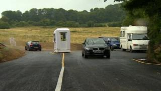 Cars passing the Kelston toll road kiosk