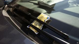 A parking ticket on a car