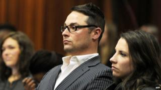 "Carl Pistorius (2nd R) and Aimee Pistorius (R), the siblings of South African paralympian Oscar Pistorius, sit at the High Court in Pretoria during Oscar Pistorius"" trial on July 2, 2014"