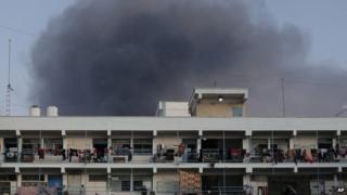 Smoke rises from rockets over a UN-run refugee camp in Jabaliya in northern Gaza