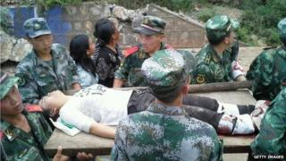 Armed police rescue the wounded in Yunnan