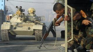 Kurdish Peshmerga forces battle IS militants in Jalawla, Diyala province. 12 July 2014