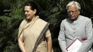 In this photograph taken on March 16, 2005, Congress Party President Sonia Gandhi (C) Natwar Singh (R) walk out of a meeting in Delhi