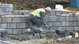 Man laying bricks