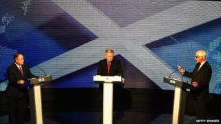 Alex Salmond ac Alistair Darling