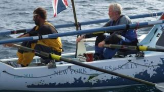 Elliott Dale and Chris Walters rowing into the Isles of Scilly