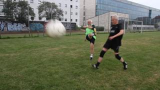 Two men playing football