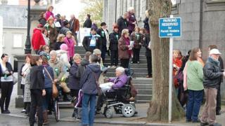 Campaigners outside Guernsey's Royal Court building