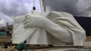 Piece of Christ statue being assembled in Colombia