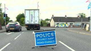 Police closed the Moira Road while officers carried out searches