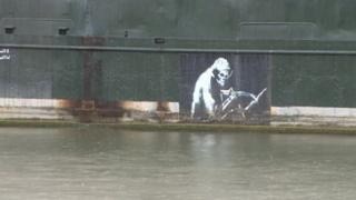 Banksy's Grim Reaper on the side of the Thekla