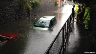 Cars trapped in flood in Cardiff