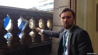 David Meikle flying Israeli flag