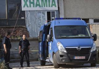 Police outside makeshift mosque in Kosovo (11 August)