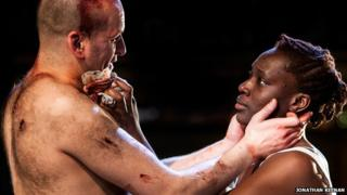 Ricky Champ as Josef the Fool (left) and Ony Uhiara as Lizaveta in Cannibals