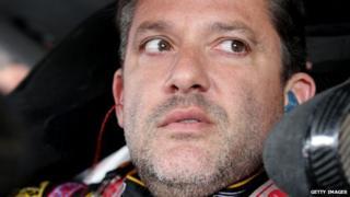 Nascar driver Tony Stewart sits at the wheel of a race car