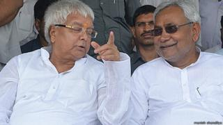 Lalu Prasad Yadav (left) says his alliance with Nitish Kumar (right) will continue to challenge the BJP