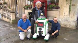 (L-R) Ady Davies of Charity Sci-Fi, David Prowse and droid and Mark Enright of Charity Sci-Fi