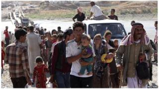 Displaced people from the Yazidi sect, fleeing the violence in Sinjar