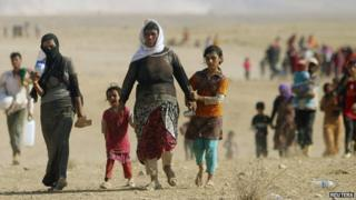Displaced people from the minority Yazidi sect, fleeing violence