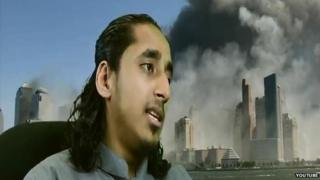 Afsor Ali in front of images of the Twin Towers