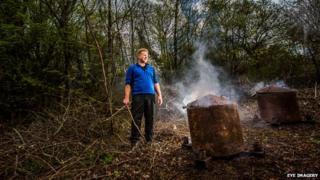 Charcoal burner Sion Jinkinson at Aberduna Nature Reserve, Denbighshire