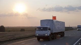 A convoy of white trucks carrying humanitarian aid passes along the main road M4 (Don highway) Voronezh region, Russia,