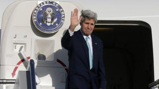 US Secretary of State John Kerry waves to officials and guests before departing from Sydney, Australia, on 13 August 2014