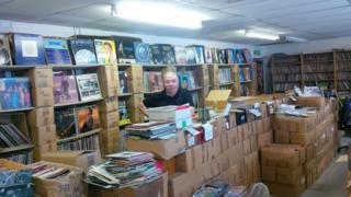 Dan Reddington with his record collection