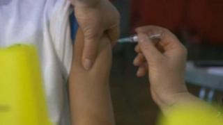 Child being vaccinated with MMR jab