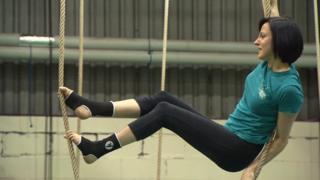 woman climbing ropes