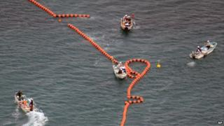 In this aerial photo, workers in boats set up no-go zone in the sea off Nago, Okinawa, southern Japan, Thursday, on 14 Aug 2014